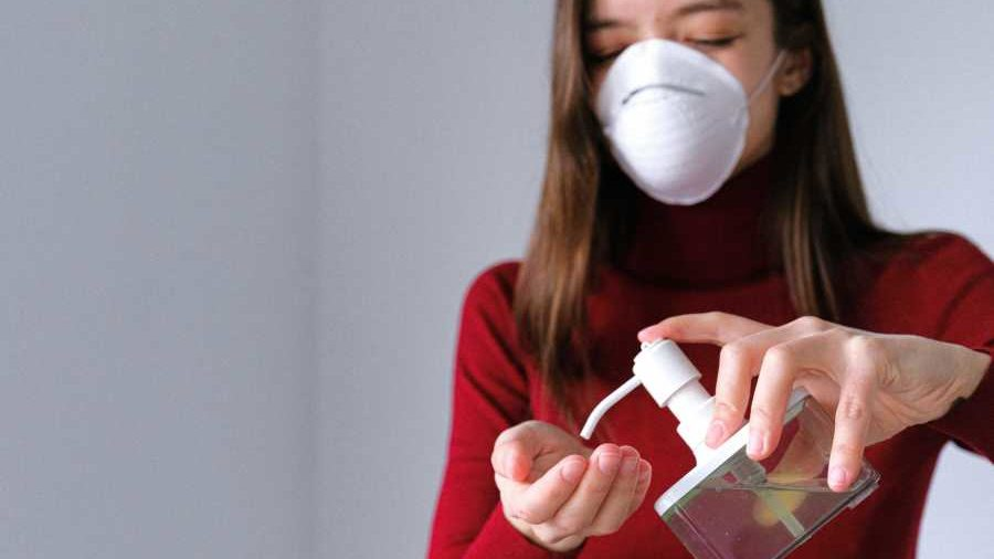 woman applying hand sanitizer 3987146 e1592394891901